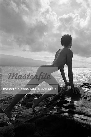 Nude woman by coast Stock Photo - Premium Royalty-Free, Image code: 604-00231409
