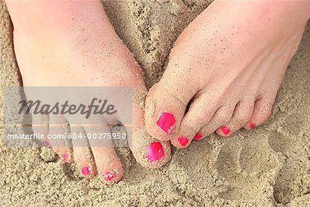Feet in sand Stock Photo - Premium Royalty-Free, Image code: 604-00275950