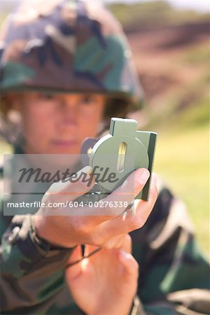 Soldier using compass scope Stock Photo - Premium Royalty-Free, Image code: 604-00276338