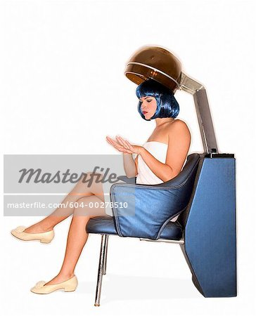 Woman under salon hair dryer/ Stock Photo - Premium Royalty-Free, Image code: 604-00278510