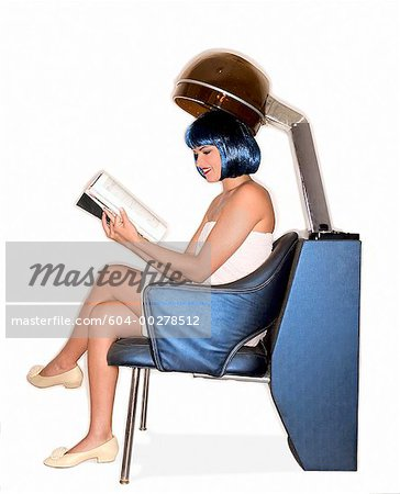 Woman reading magazine under salon hair dryer/ Stock Photo - Premium Royalty-Free, Image code: 604-00278512