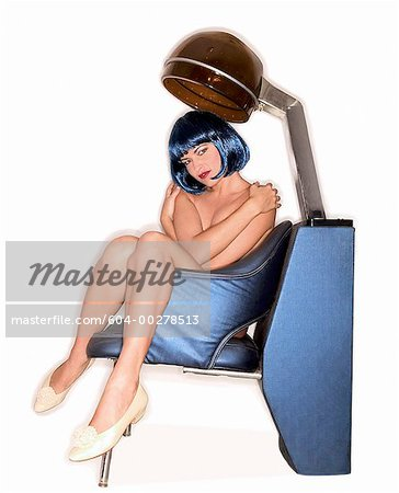 Nude woman sitting under salon hair dryer/ Stock Photo - Premium Royalty-Free, Image code: 604-00278513