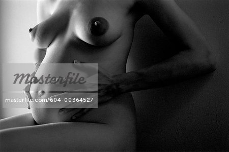 Torso of nude pregnant woman/ Stock Photo - Premium Royalty-Free, Image code: 604-00364527