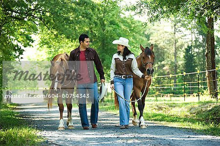 Couple with horses Stock Photo - Premium Royalty-Free, Image code: 604-00754343