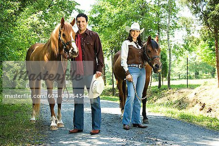 Couple with horses Stock Photo - Premium Royalty-Free, Image code: 604-00754344