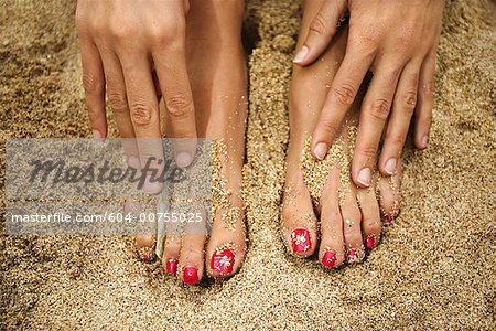Feet and hands in sand/ Stock Photo - Premium Royalty-Free, Image code: 604-00755025