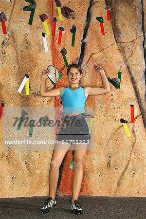 Teenage girl by rock climbing wall Stock Photo - Premium Royalty-Free, Image code: 604-00755202