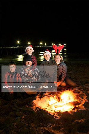 Family and campfire on beach Stock Photo - Premium Royalty-Free, Image code: 604-00760236