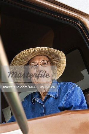 Woman in truck/ Stock Photo - Premium Royalty-Free, Image code: 604-00939024