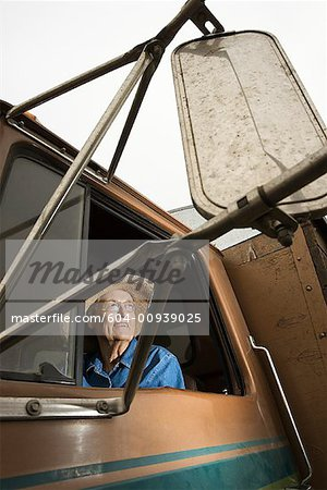 Woman in truck/ Stock Photo - Premium Royalty-Free, Image code: 604-00939025