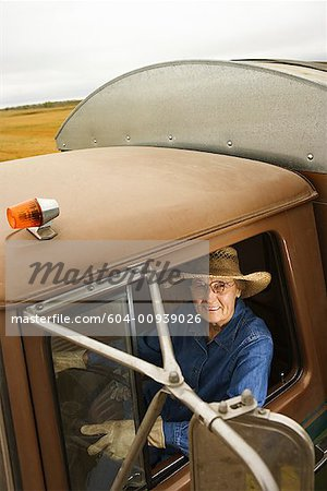 Woman in truck/ Stock Photo - Premium Royalty-Free, Image code: 604-00939026