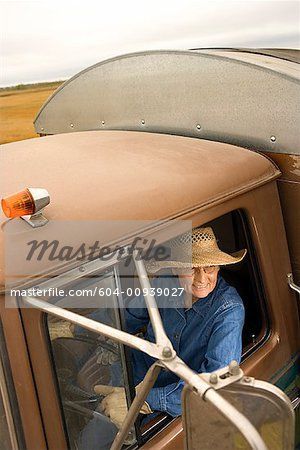 Woman in truck/ Stock Photo - Premium Royalty-Free, Image code: 604-00939027