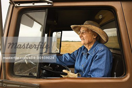 Woman in truck/ Stock Photo - Premium Royalty-Free, Image code: 604-00939028