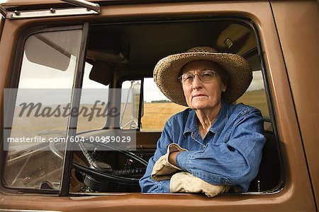Woman in truck/ Stock Photo - Premium Royalty-Free, Image code: 604-00939029