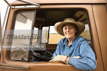Woman in truck/ Stock Photo - Premium Royalty-Free, Image code: 604-00939030