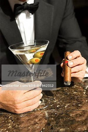 Man with Martini and Cigar/ Stock Photo - Premium Royalty-Free, Image code: 604-00942312
