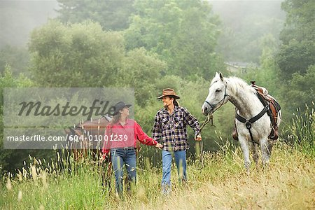 Couple with horses/ Stock Photo - Premium Royalty-Free, Image code: 604-01001239