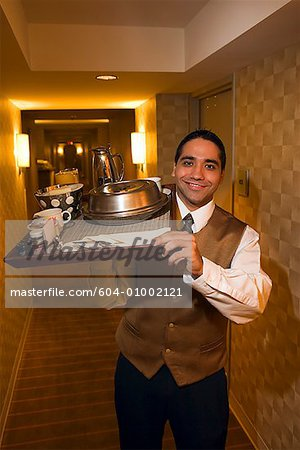 Waiter with room service/ Stock Photo - Premium Royalty-Free, Code: 604-01002121