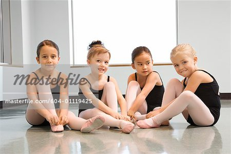 Ballet students adjusting slippers Stock Photo - Premium Royalty-Free, Image code: 604-01119425