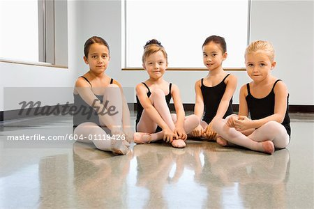 Ballet students adjusting slippers Stock Photo - Premium Royalty-Free, Image code: 604-01119426