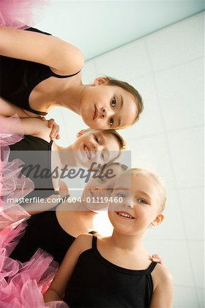 Low angle portrait of girls in ballet class Stock Photo - Premium Royalty-Free, Image code: 604-01119460