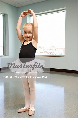 Girl in ballet class practicing Stock Photo - Premium Royalty-Free, Image code: 604-01119462