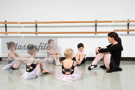 Children in ballet class watching instructor Stock Photo - Premium Royalty-Free, Image code: 604-01119491