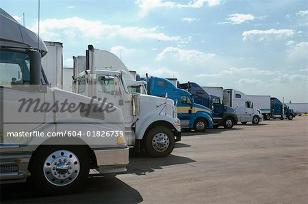 Row of semi-trucks Stock Photo - Premium Royalty-Free, Image code: 604-01826739