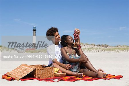 Couple having picnic on beach Stock Photo - Premium Royalty-Free, Image code: 604-02043693