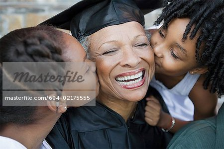 Granddaughters kissing grandma Stock Photo - Premium Royalty-Free, Image code: 604-02175555