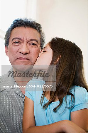 Granddaughter kissing grandpa Stock Photo - Premium Royalty-Free, Image code: 604-02175575