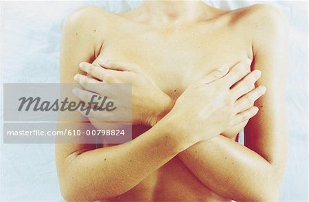 naked woman hiding her breast Stock Photo - Premium Royalty-Free, Image code: 610-00798824