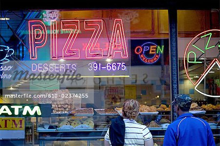United States, New York, Manhattan, near Times square, neon sign and pastries in a window shop Stock Photo - Premium Royalty-Free, Image code: 610-02374255