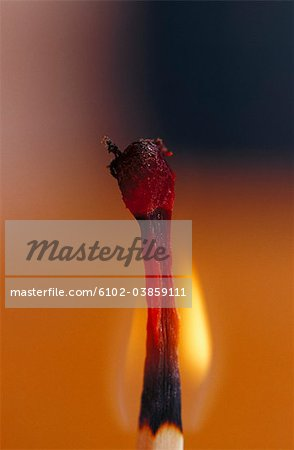 Close-up of flaming match stick Stock Photo - Premium Royalty-Free, Image code: 6102-03859111