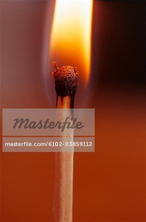 Close-up of flaming match stick Stock Photo - Premium Royalty-Free, Image code: 6102-03859112