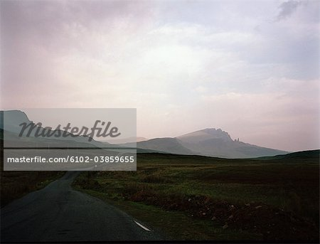 View of country road with mountains in background Stock Photo - Premium Royalty-Free, Image code: 6102-03859655