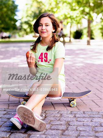 A girl with a skateboard, Sweden. Stock Photo - Premium Royalty-Free, Image code: 6102-03865943