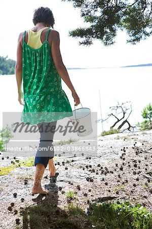 Woman in green dress by the sea, Sweden. Stock Photo - Premium Royalty-Free, Image code: 6102-03866843