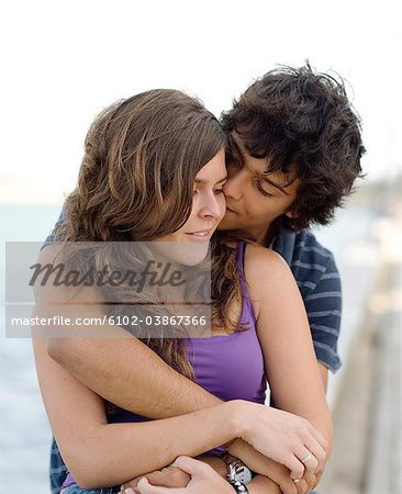 A young couple hugging, Portugal. Stock Photo - Premium Royalty-Free, Image code: 6102-03867366