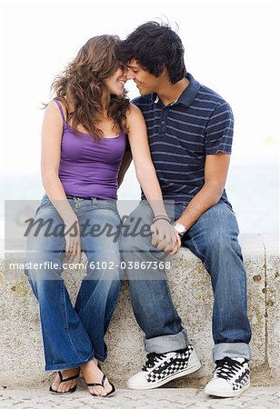A young couple hugging, Portugal. Stock Photo - Premium Royalty-Free, Image code: 6102-03867368