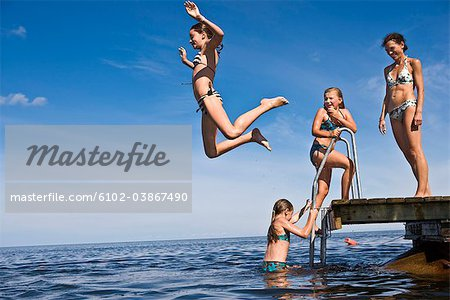 Mother and daughters swimming, Oland, Sweden. Stock Photo - Premium Royalty-Free, Image code: 6102-03867490