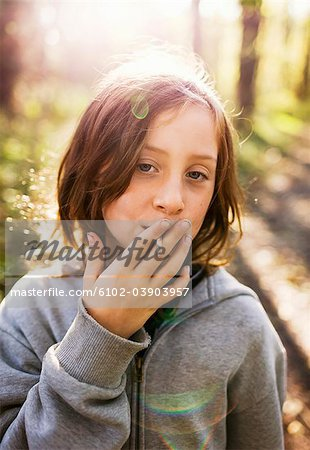 A girl pretending to smoke, Sweden. Stock Photo - Premium Royalty-Free, Image code: 6102-03903957
