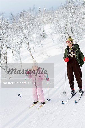 Mother and daughter skiing, Sweden. Stock Photo - Premium Royalty-Free, Image code: 6102-03905129
