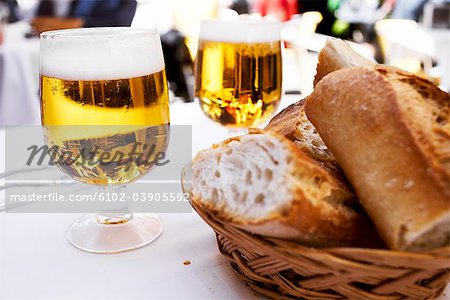 Beer and bread on a table, Spain. Stock Photo - Premium Royalty-Free, Image code: 6102-03905592