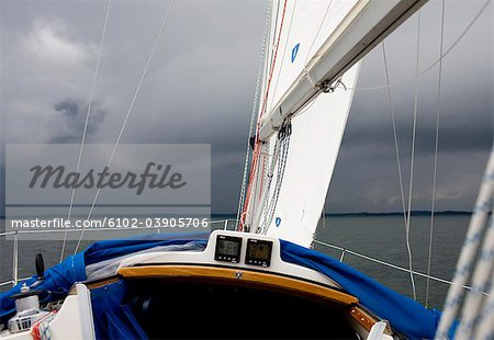 Sailing boat in stormy weather Stock Photo - Premium Royalty-Free, Image code: 6102-03905706