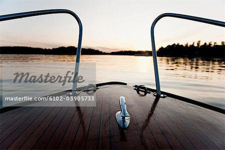 View of river and hills from deck of boat Stock Photo - Premium Royalty-Free, Image code: 6102-03905733