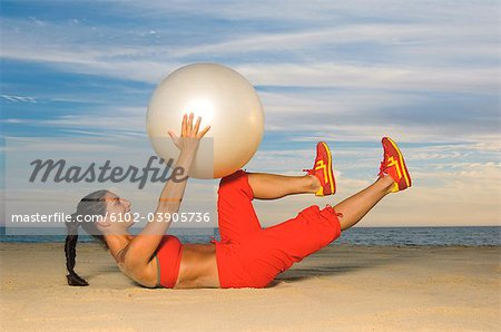 Woman exercising with fitness ball Stock Photo - Premium Royalty-Free, Image code: 6102-03905736