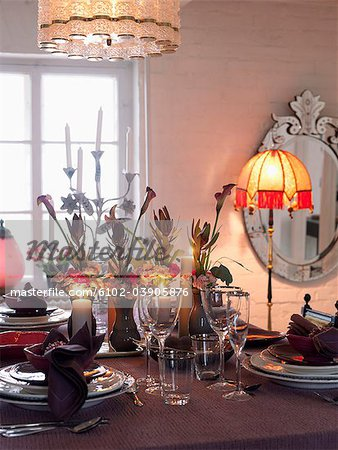 Dining table laid out Stock Photo - Premium Royalty-Free, Image code: 6102-03905876