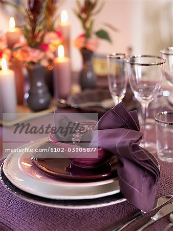 Place setting at dining table Stock Photo - Premium Royalty-Free, Image code: 6102-03905877