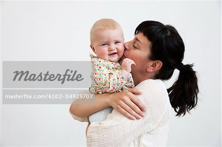 Mother kissing daughter Stock Photo - Premium Royalty-Free, Image code: 6102-04929707